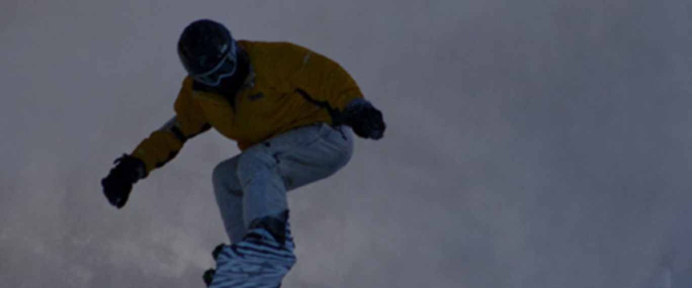 Retreats snowboarder